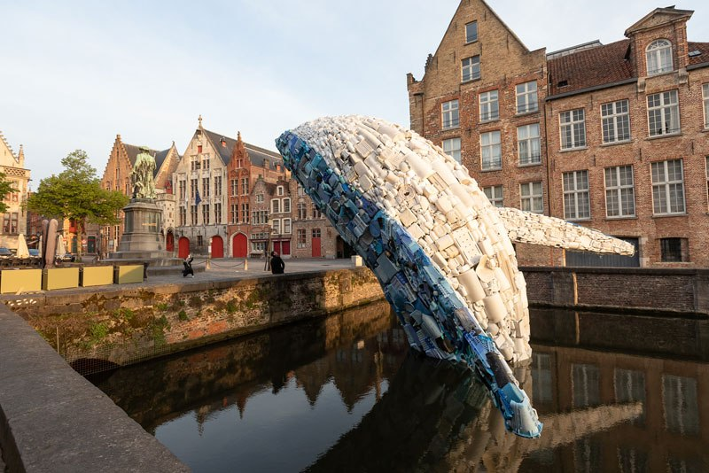 giant whale made from 10000 pounds of plastic ocean waste by studiokca bruges triennial 6 A 38 ft Tall Breaching Whale Made From 10,000 Pounds of Plastic Ocean Waste