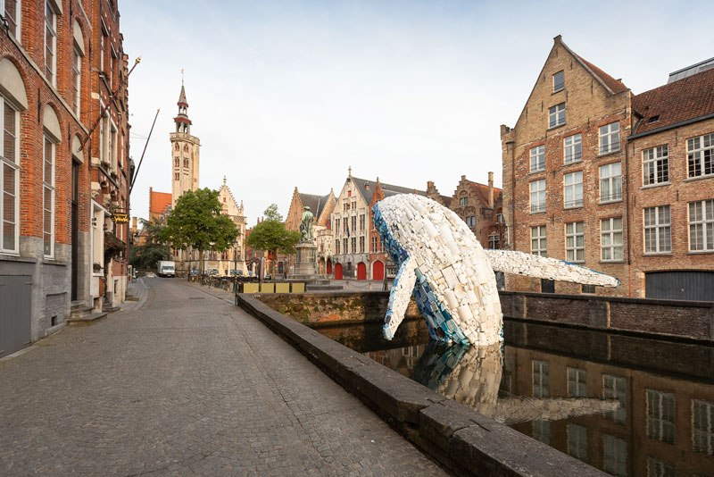 giant whale made from 10000 pounds of plastic ocean waste by studiokca bruges triennial 7 A 38 ft Tall Breaching Whale Made From 10,000 Pounds of Plastic Ocean Waste