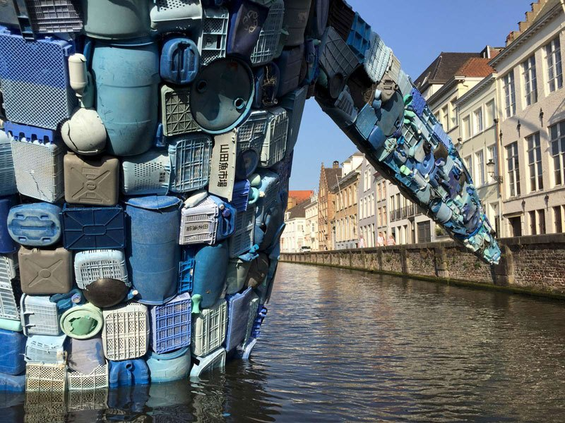 giant whale made from 10000 pounds of plastic ocean waste by studiokca bruges triennial 3 A 38 ft Tall Breaching Whale Made From 10,000 Pounds of Plastic Ocean Waste